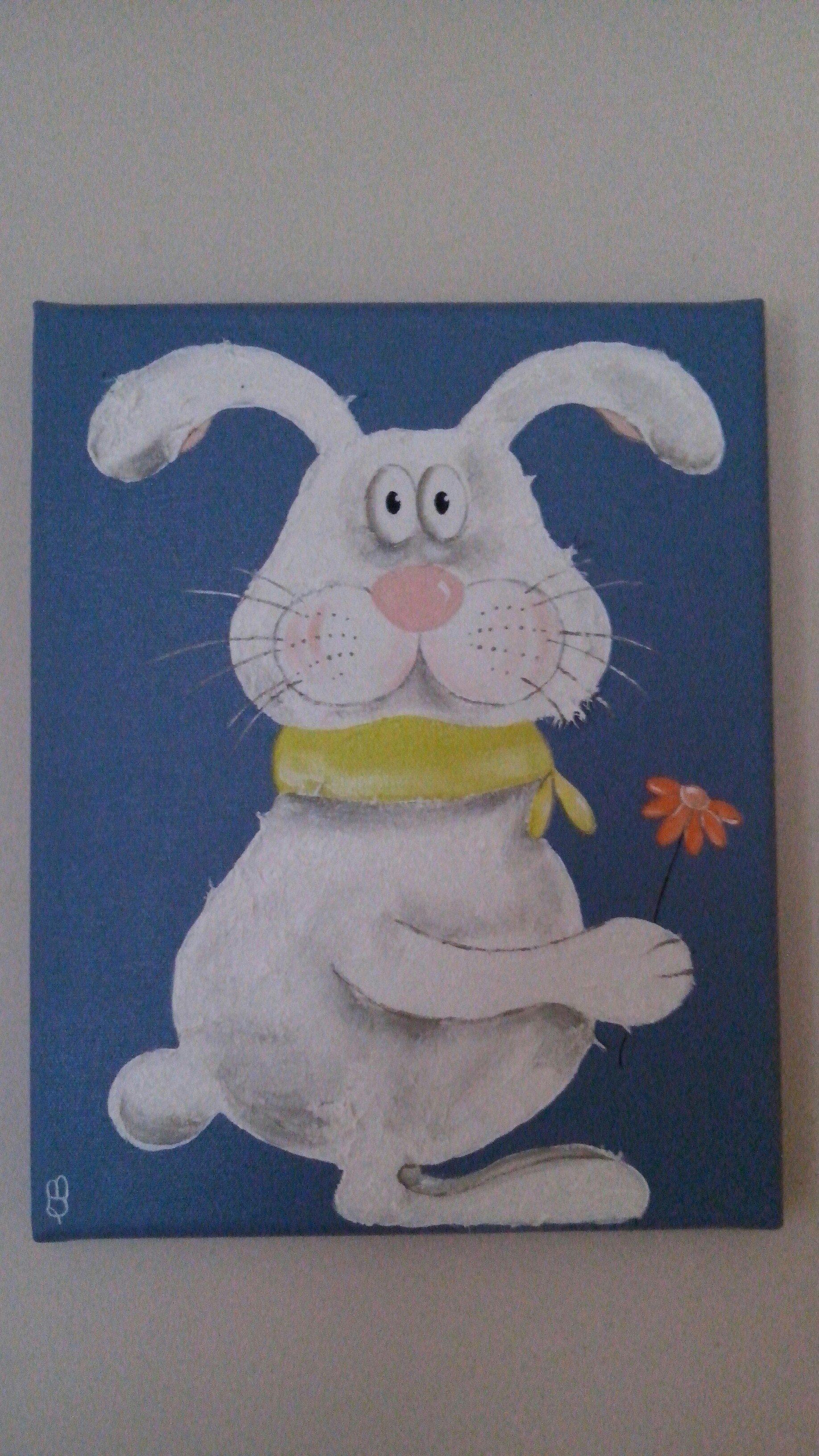 Ein Bild von einem weißen Comic-Hasen mit Blume vor einem blauen Hintergrund